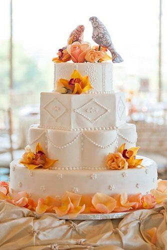 fall wedding cakes unique with peach and yellow orchids and birds on top memoire studio