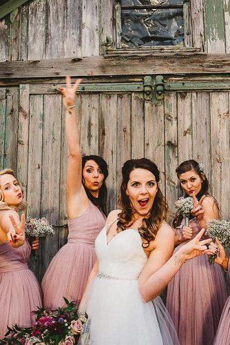 funny wedding pictures bride with bridesmaids poses near the house ayesha photography