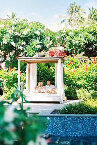 hawaii honeymoon couple on a lounger in the courtyard among the green agoodwin1