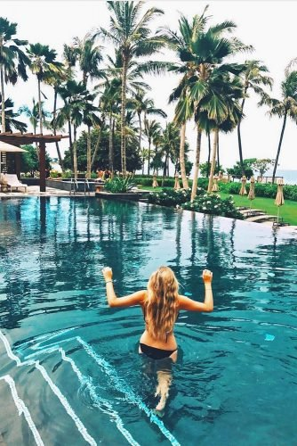 hawaii honeymoon girl walks into the pool jennafisch