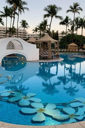 hawaii honeymoon swimming pool with a white mosquito and white tropical flowers at the bottom lukeness17