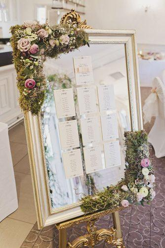 mirror wedding ideas table setting in gold frame decorated with moss and roses tracy weston photography