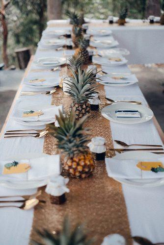 non floral wedding centerpieces gold tablerunner with pineapples raconteur photography