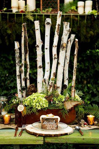 non floral wedding centerpieces in a wooden box birch branches and moss azure b photography