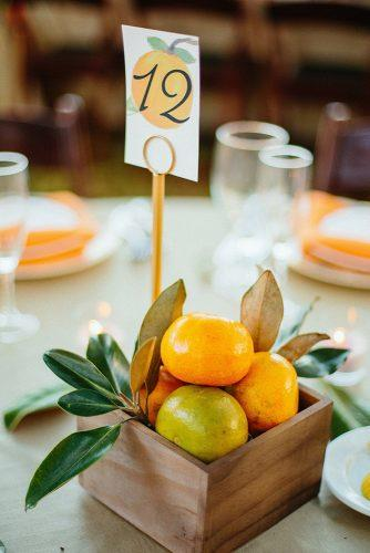 non floral wedding centerpieces in wooden crate lemons and table number sunglow photography