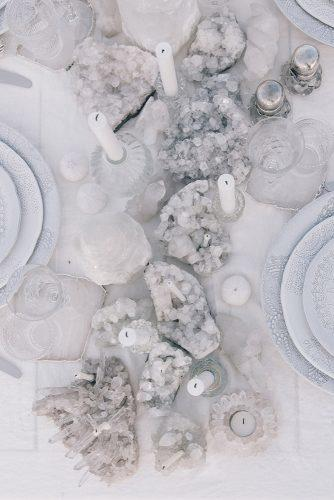 non floral wedding centerpieces nautical gray geode and candles on the table the lane via instagram