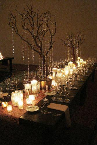 non floral wedding centerpieces withcandles and tall branches crystals encore creative
