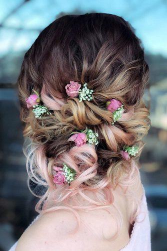romantic bridal updos wedding hairstyles curly low bun with pink roses styles_by_reneemarie