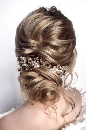 romantic bridal updos wedding hairstyles low textured curly bun with accessory hair_vera