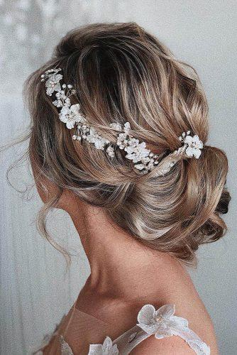 romantic bridal updos wedding hairstyles low updo with soft curls with silver halo ulyana aster via instagram