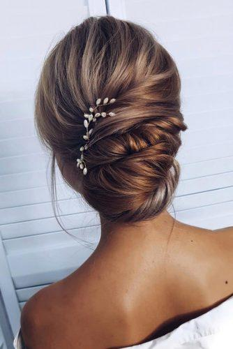 romantic bridal updos wedding hairstyles simple elegant textured low updo with pearly accessory ksenya_makeup