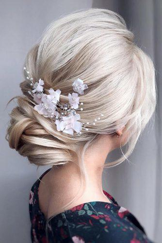 romantic bridal updos wedding hairstyles simple low updo on blonde hair with white flower pins hair_vera
