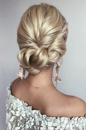 romantic bridal updos wedding hairstyles simple side swept low updo on blonde hair caraclynebridal