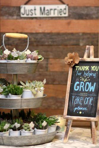 rustic barbecue bbq wedding a metal stand with succulents and warm words about love for guests andy sams photography