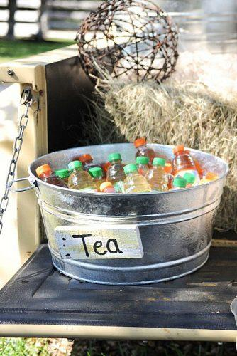 rustic barbecue bbq wedding bottles of tea in an iron bucket eureka photography