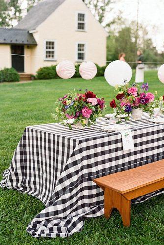rustic barbecue bbq wedding reception with flowers and checkered tablecloth karen hill