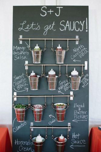 rustic barbecue bbq wedding stand with sauces and seasonings for barbecue natalie franke photography