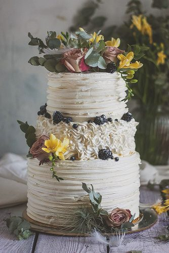 textured wedding cakes cream with flowers and berries maria bondareva via instagram