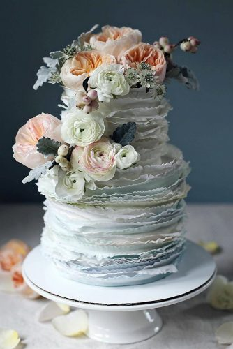 textured wedding cakes gently blue cake with fresh flowers sparks & cakes via instagram
