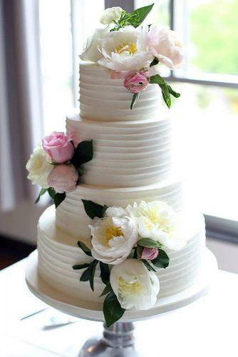 textured wedding cakes white cream decorated with pink roses amy cakes llc via instagram
