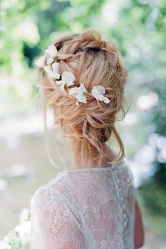 wedding hairstyles for medium hair messy updo with a braid texture and white flowers on blond hair hair and makeup by steph via instagram