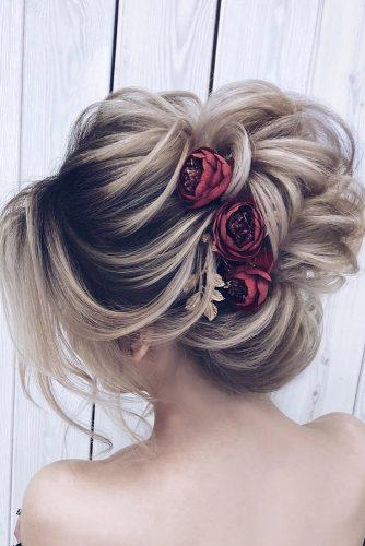 wedding hairstyles medium hair elegant high textured updo with red flowers pins milagolubeva