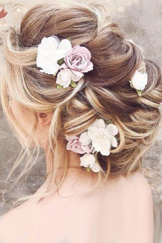wedding hairstyles with flowers updo with pink flowers brooke klay