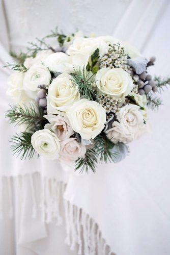 winter wedding bouquets with white roses and spruce branches flowers by janie via instagram