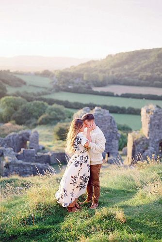 best honeymoon destinations couple hugging in the green vastness of ireland imogen xiana