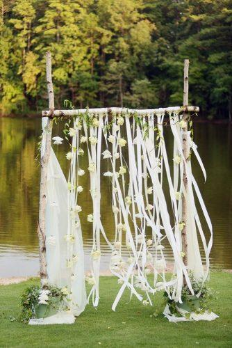 country wedding breach tree wooden arch with white flowers and ribbons jwoodberry photography