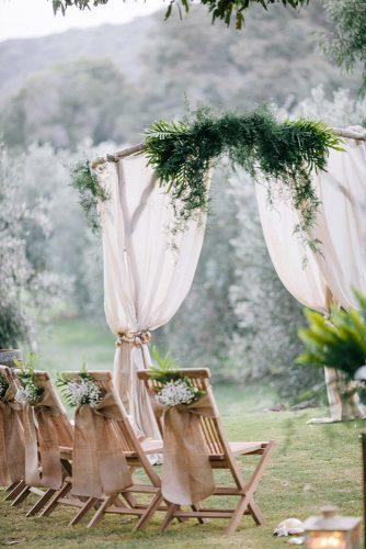 country wedding bridal ceremony decorated with burlap and greenery elizabeth anne designs