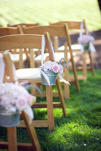 country wedding buckets with pink roses and ribbons decorated the aisle julie mikos photography