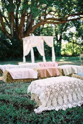 country wedding ceremony vintage lace and hay bales seatings feather and stone