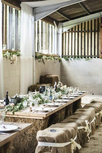 country wedding hay bale seatings and table with burlap and wood eleanor jane weddings