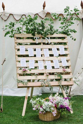 country wedding pallet stand decorated with breenery and flowers lucy_davenport via instagram