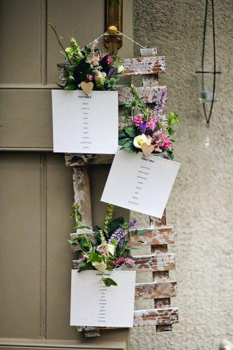 country wedding pallet stand decorated with greenery and flowers we heart pictures