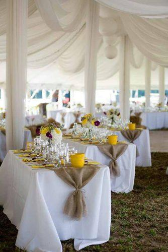 country wedding reception under white tent with gold accents janas corner