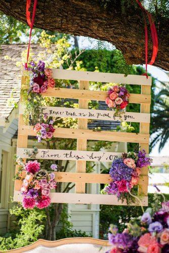 country wedding suspended pallet with flowers and sign barnet photography