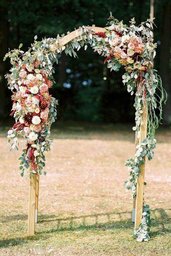 country wedding wooden arch decorated with flowers ashley ludaescher photography