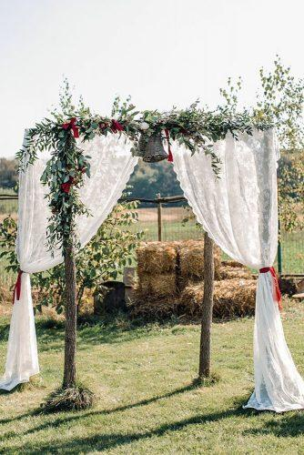 country wedding wooden arch decorated with lace and greenery deaalexandroni via instagram