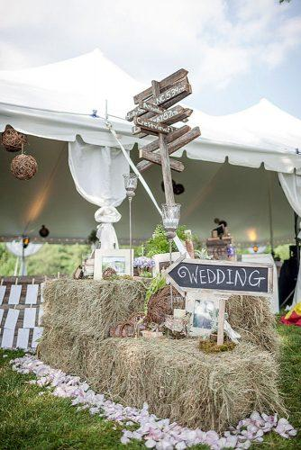 country wedding wooden signs decorated with hay bale sara lobla photography