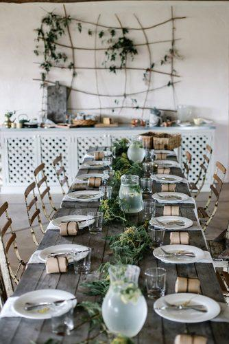 country wedding wooden table with greenery luisa brimble