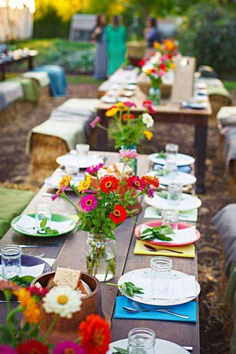 country wedding woodland tables with bright cloth and flowers nate luke and blaine moats