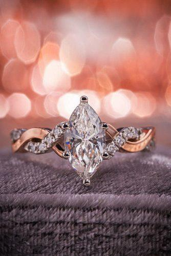 engagement ring marquise cut diamond twist gold