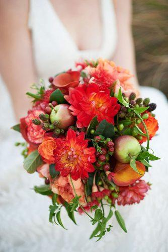 fall wedding bouquets orange with dahlias and apples nikole ramsay photography
