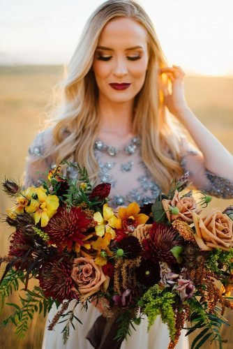fall wedding bouquets volume with yellow and burgundy flowers greenery madisondhuartphoto