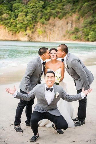 groomsmen photos bride with groomsmen on the beach storiesweddingphoto