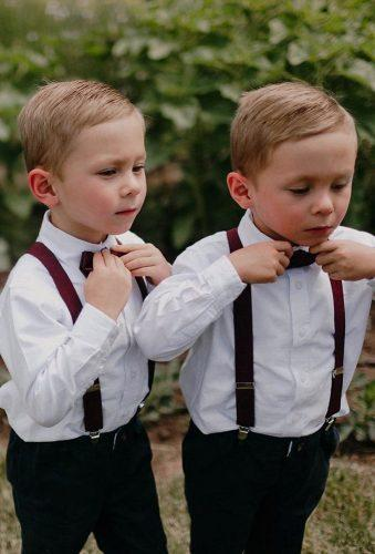 groomsmen photos two boys with butterfly lyonsfarmette