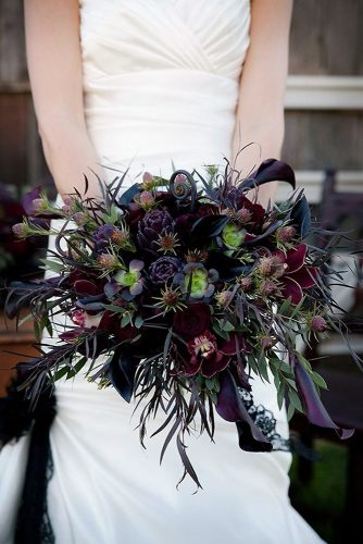 halloween wedding ideas a dark bouquet with orchids with a green and purple hue cameraartphoto