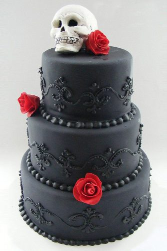 halloween wedding ideas black cake decorated with patterns and red roses on top of the skull weddingsbybittersweets